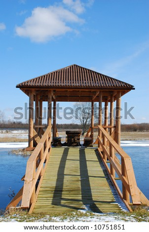 Wooden bridge with summer-house