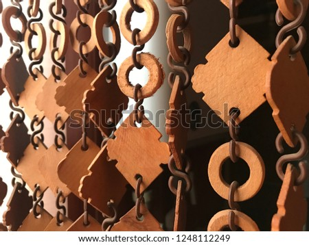Wooden brown curtain made from rings and rhombus linked, closeup #1248112249