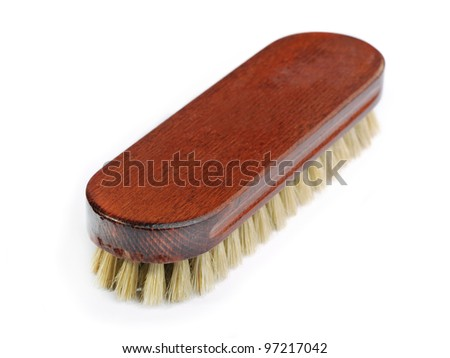 Wooden brush isolated on the white background