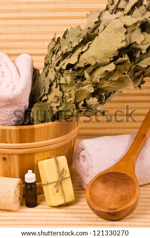 Wooden bucket with sauna accessories and toiletries