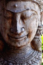 Wooden Buddha Statue with Cropped  Head and in Heavy Light and Shadow. Buddhism icon.