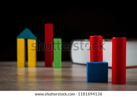 Wooden building blocks collocate on wooden table with still life concept,Circular shape,Square shape,Triangle shape. #1181694136