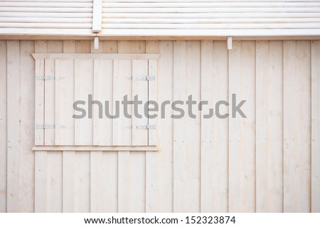 Wooden building house on beach. Window on wooden white house wood background - stock photo