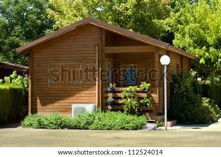 Wooden bungalow and garden