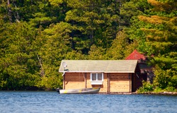 Wooden cabin and a boat