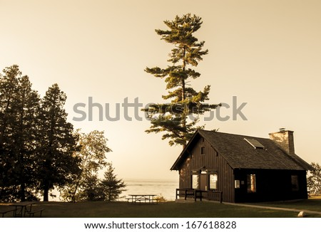 wooden cabin by the lake ...
