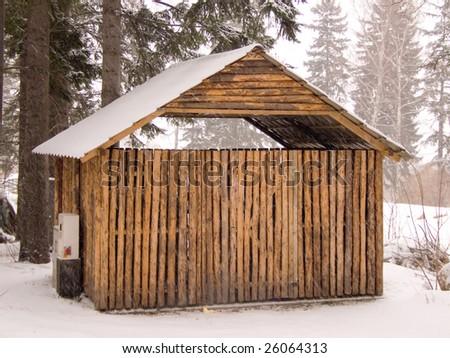 Wooden cabin in winter scenery