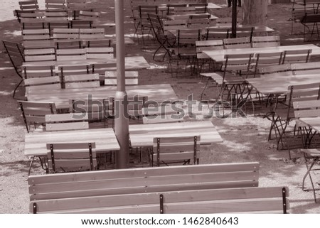 Wooden Cafe Tables and Chairs; Frankfurt; Germany in Black and White Sepia Tone