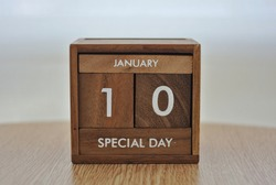 Wooden calendar on January​ 10​ on the wooden background, the concept of​ Peculiar People Day .