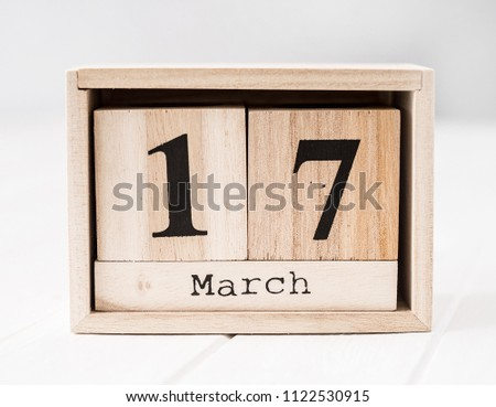 Wooden calendar that shows seventeenth of march