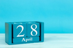 wooden calendar with date 28 april on blue wooden background, World Disco Soup Day; International Day of Remembrance for All Victims of Labor; World Day for Safety and Health at Work; Jeans day
