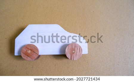 Wooden car miniature toy foe ducational purpose on black background. Photo stock ©