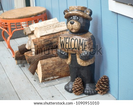 wooden carved bear welcoming...