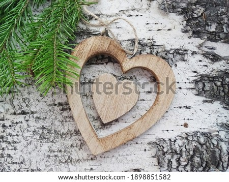 wooden carved heart and green fir branches on a birch bark background                                 Photo stock ©