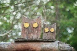 Wooden carved owls in the garden. Handmade flat garden sculptures. DIY.
