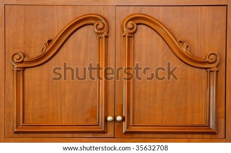 Wooden carved wardrobe doors closeup