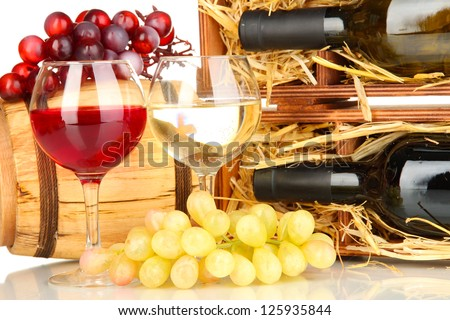 Wooden case with wine bottle, barrel, wineglasses and grape close up