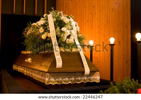 Wooden caseket at a funeral - funereal ceremony