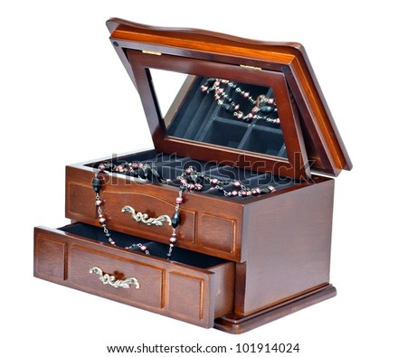 wooden casket with a mirror for ornaments. It is isolated on a white background