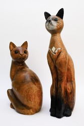 Wooden cat in elegant posture