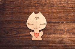 wooden cat with valentine on a wooden background
