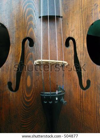 Wooden cello with shadows