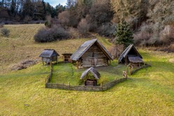 Wooden Celtic dwelling  on meadow under the forest