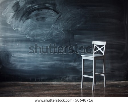 Wooden chair against a school desk for the letter. Impressive background