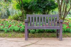 Wooden chair in garden.