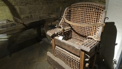 Wooden chair of torture displayed in a museum of medieval justice