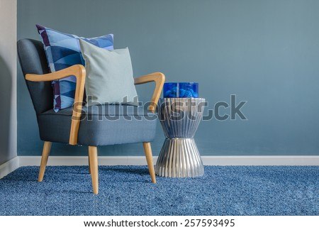 wooden chair with blue color...