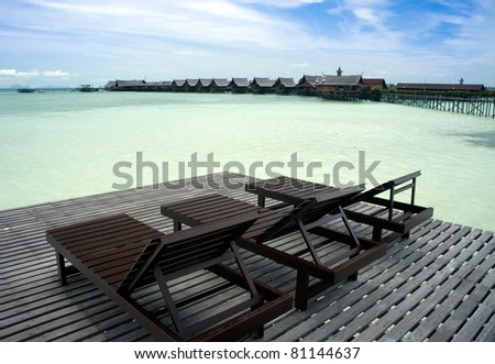 wooden chairs for visitors to view a man-made kapalai resort