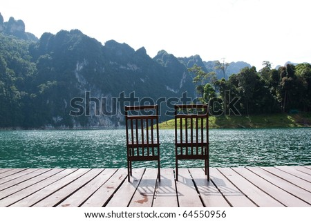 Wooden chairs on the lake