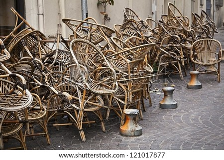 Wooden chairs piled up next to a restaurant in Aix-en Provence in the South of France.
