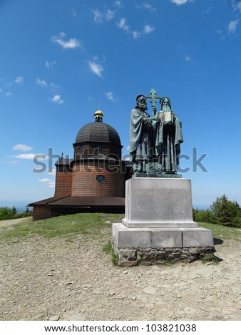 Wooden Chapel and Bronze Statue of Saint Cyril and Methodius on Radhost in Beskydy Mountains, Czech Republic