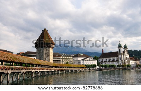Wooden Chapel bridge and Jesuit church in old town of Lucerne,  Switzerland