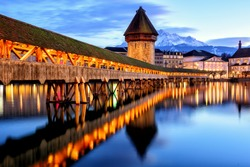 Wooden Chapel Bridge, Water Tower and Mount Pilatus in the Old Town of Lucerne, Switzerland, in the late evening light