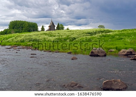 Wooden chapel on the banks of the river Keret. At this point the Keret River flows into the White Sea. Karelia, Russia, end of June. Stock fotó ©