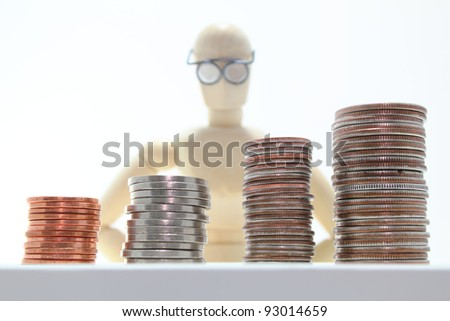 Wooden character with wire frame glasses watching money.