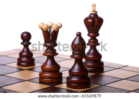 Wooden chess pieces on a chess board. Isolated on white, shallow DOF