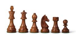 wooden chess pieces on a white