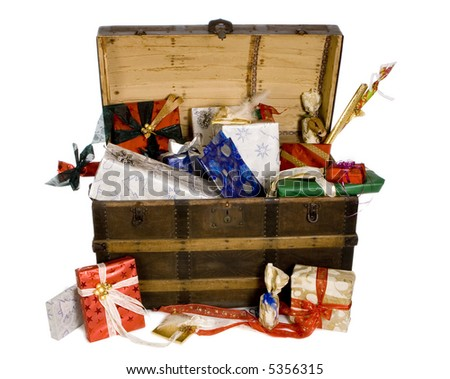 Wooden chest filled with lots of presents for christmas or birthday
