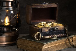 wooden chest with gold coins and treasure key, concept of wealth, pirate treasure,