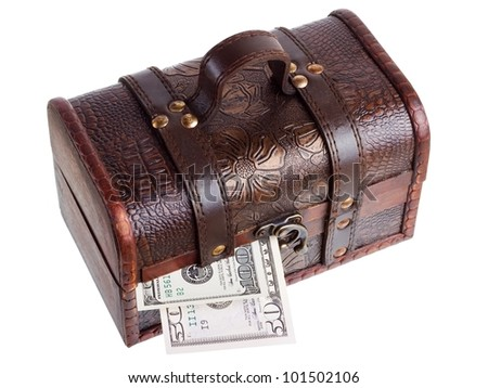 Wooden chest with money isolated on the white background