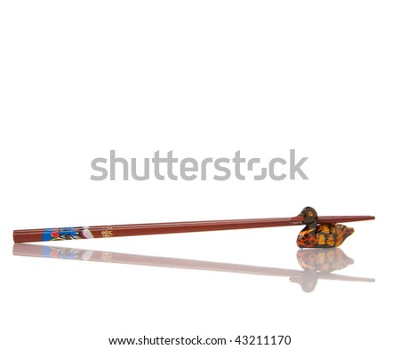 Wooden chopsticks on white with reflection