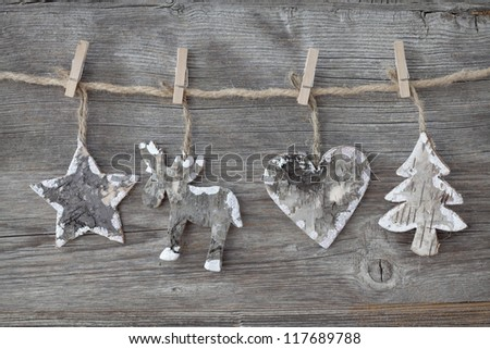Wooden christmas decoration on wooden background