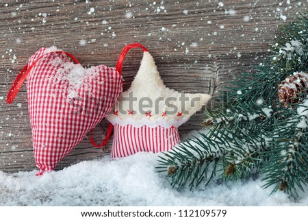 Wooden christmas star and heart decoration on wooden background
