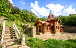 Wooden church in mountains scene. Mountain church view. Wooden church scene. Mountain wooden church