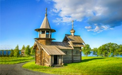 Wooden church on summer rural landscape. Wooden church. Church in village. Rural wooden church