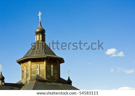 wooden church over blue sky